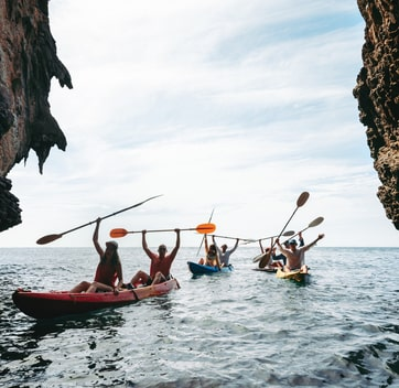 People canoeing on group glamping trip