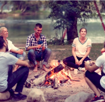 large groups glamping by a fire